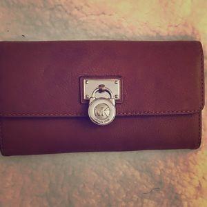 Michael Kors cognac leather wallet.
